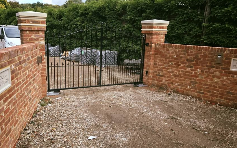 Installation in Wickham bishops Double set of underground operators Roger technology with intercom using connect 4 , exit keypad and hold open switch Black gloss wrought iron gates with features in middle