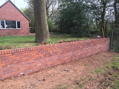 New Retaining Wall To Match Extension