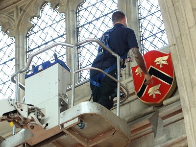 Shield being placed in Guildhall
