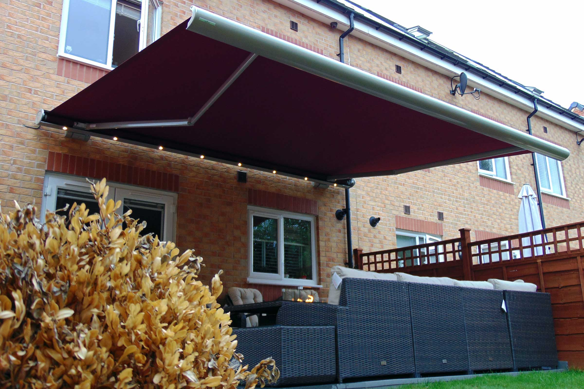 The Semina Life LED awning with red fabric