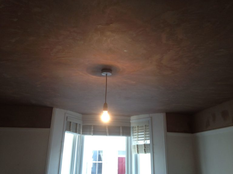 Newly plastered ceiling after a hole had been boarded up.