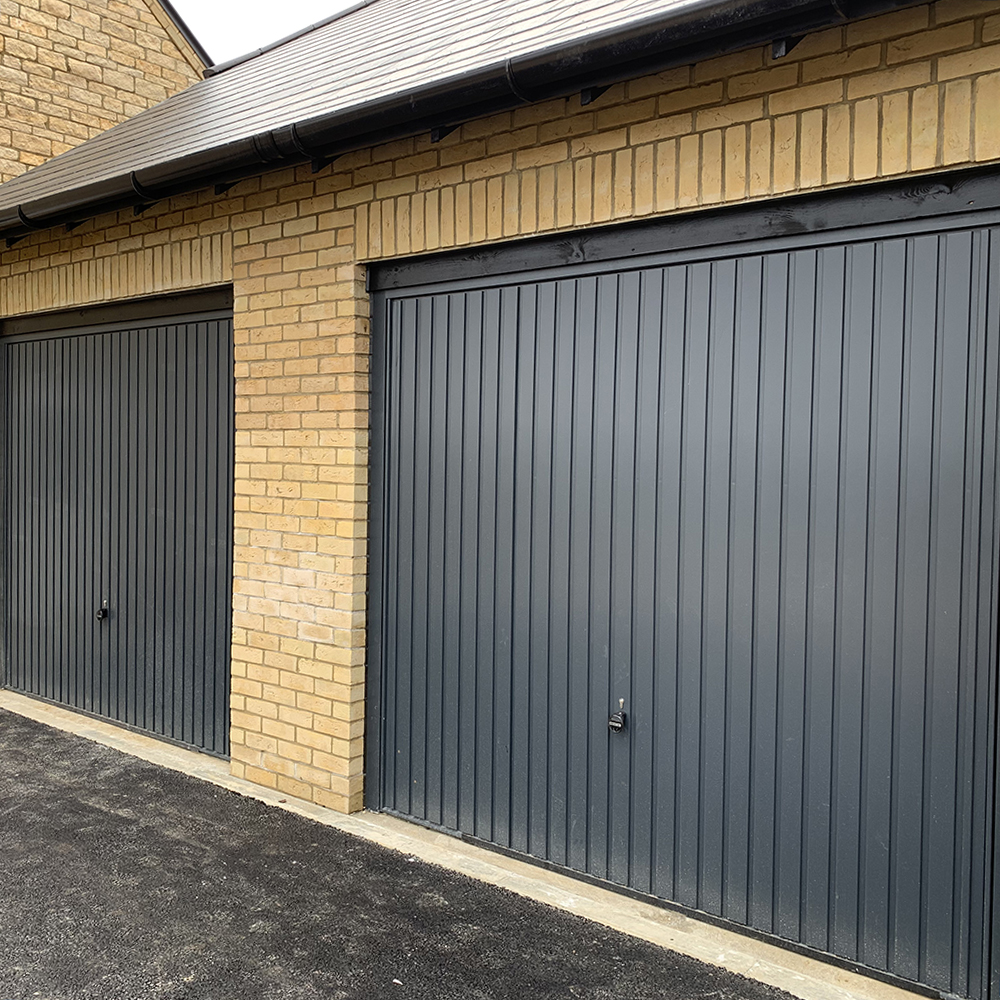 Single Garador steel vertical canopy garage doors finished in anthracite grey.