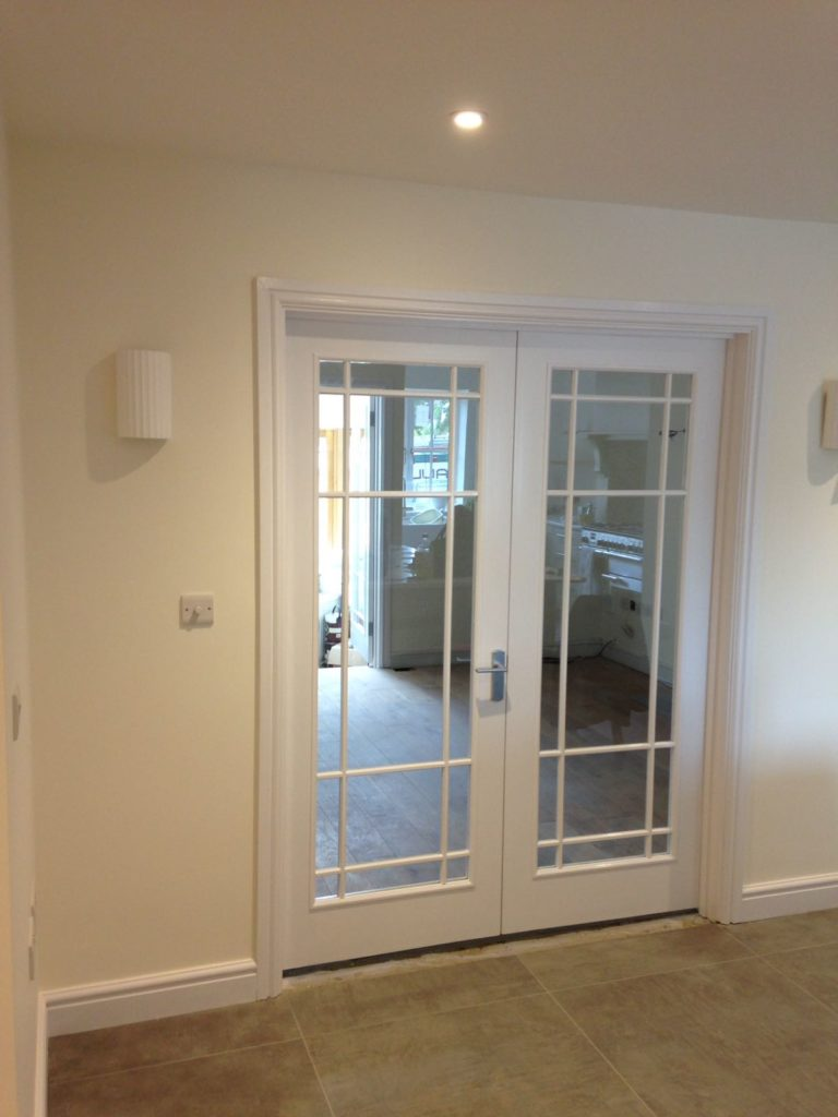 Newly decorated room and painted glass doors.