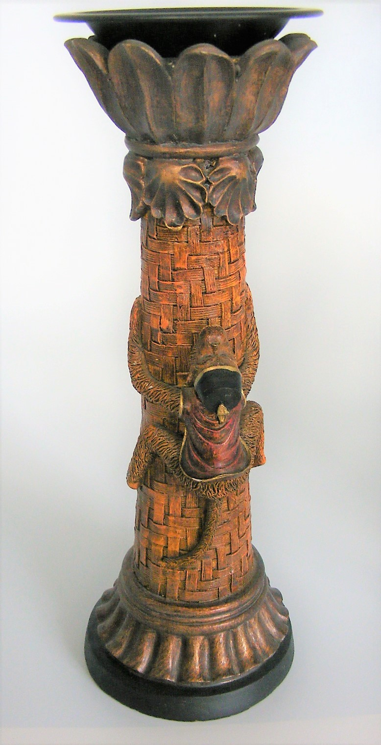 A fez wearing Moroccan monkey climbing a palm tree 14-inch-tall candle holder