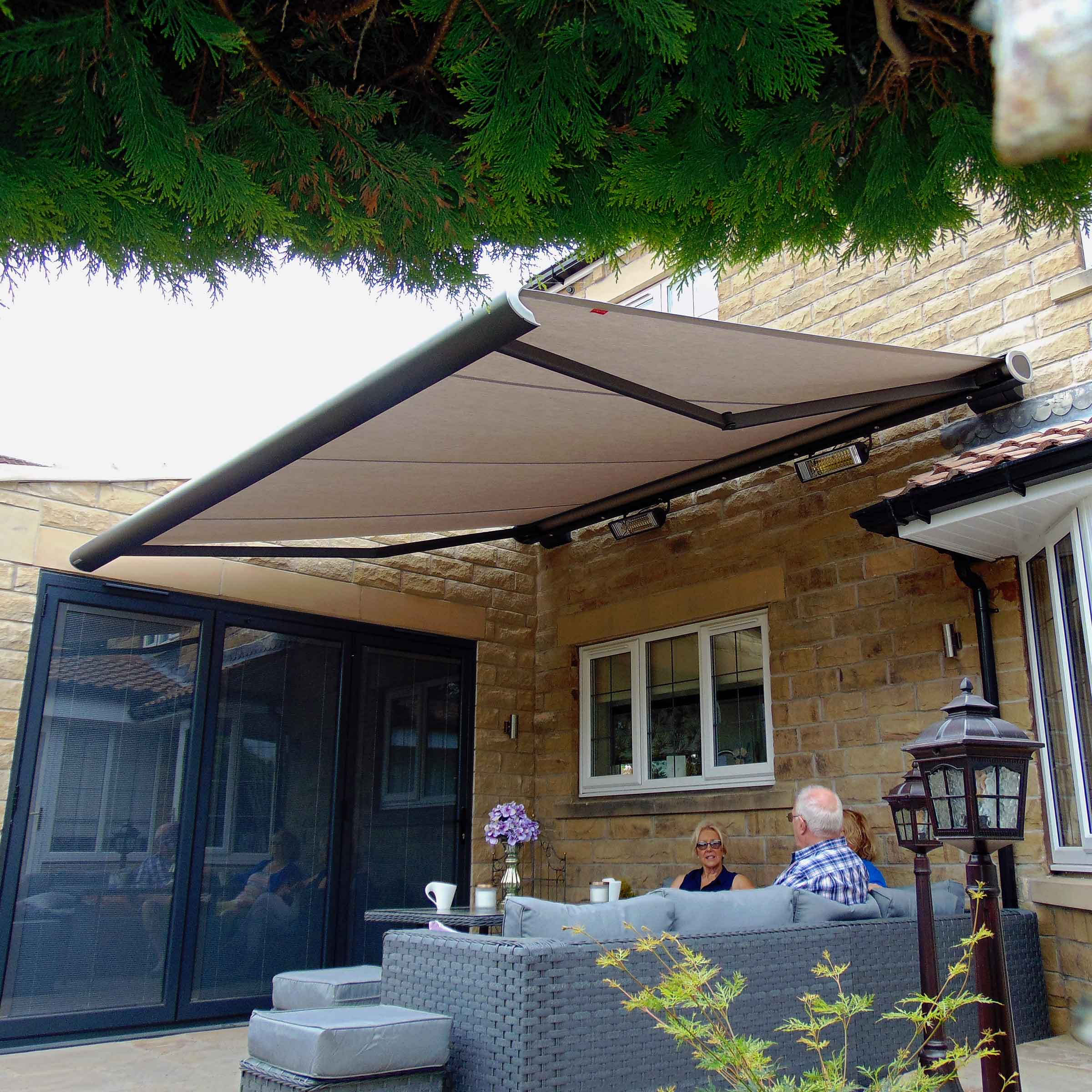 A family enjoying relaxing under their Alcas Awning