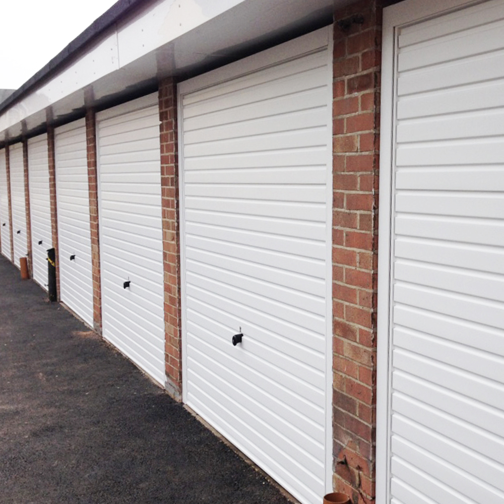 Single Hormann steel horizontal canopy garage doors finished in white with white frames.