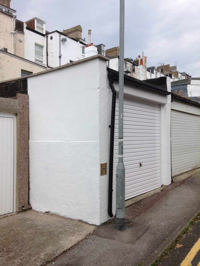 White decorated garage door and side of garage.