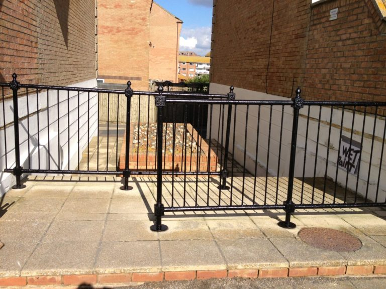Newly redecorated and restored black railings.