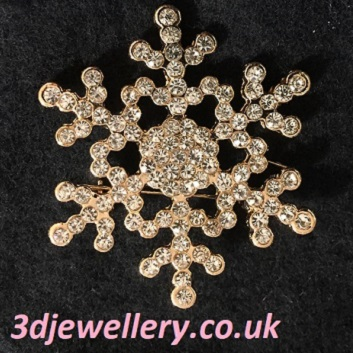 Small gold snowflake brooch 35 mm