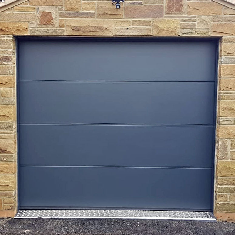 Grey L ribbed sectional garage door