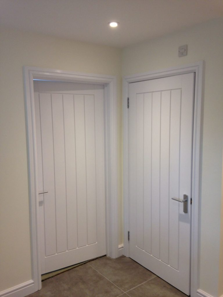 White doors and white skirtings freshly painted. Redecorated ceiling and walls.