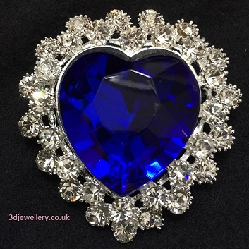 Coloured brooches - heart shaped diamante brooch with large blue centre 45 x 55 mm