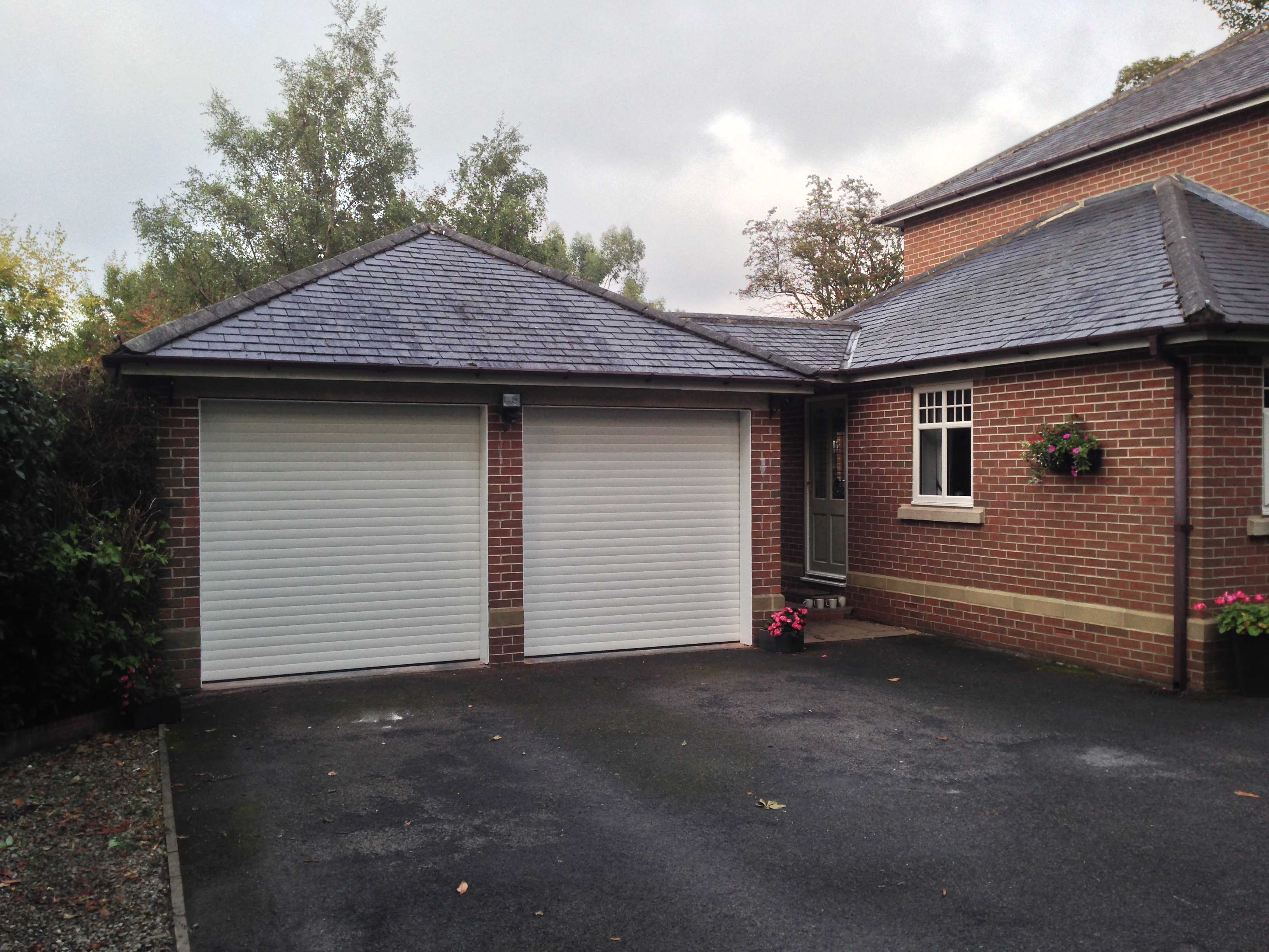 Twin white roller garage doors