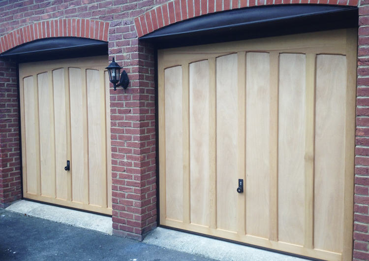Timber garage door gallery, featuring a selection of timber cedar doors and timber effect steel garage doors installed by Garage Door Solutions Limited. Available in up and over, sectional and side hinged garage doors. Designs including vertical, horizontal, georgian and traditional patterns with window options and a wide range of wood and paint finishes.