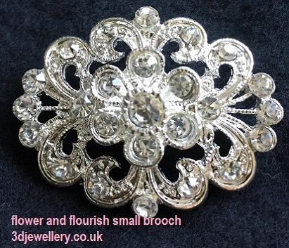 Small diamante brooches- flower and flourish silver brooch 35 x 28 mm