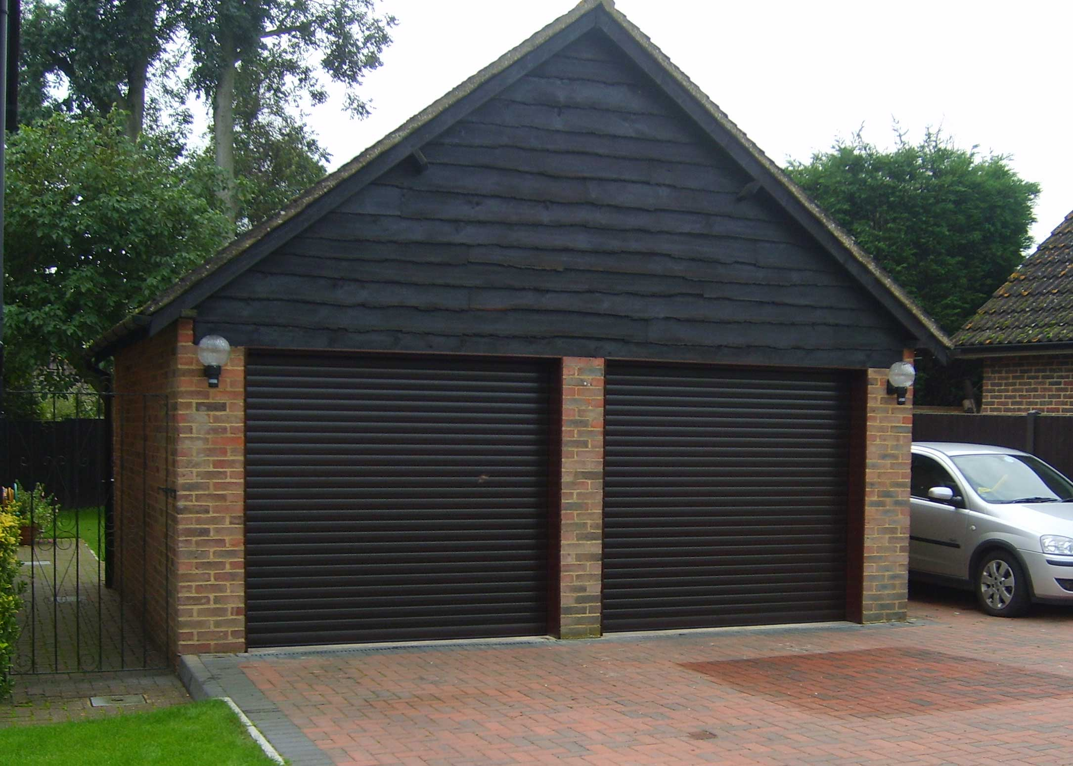 Brown twin roller doors detached garage