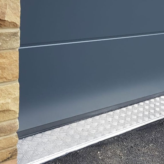 Grey L ribbed sectional garage door close up