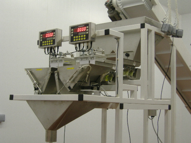Proweight Twin Head Batch Weigher with stainless steel contact parts for food industries.